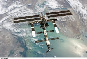 Earth seen from the ISS and human space-travelers