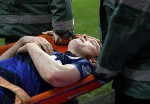 Manchester United's Jones is carried off the pitch on a stretcher during their English Premier League soccer match against Arsenal in London